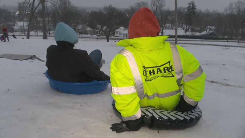 People enjoy the winter weather at hospital hill Wednesday