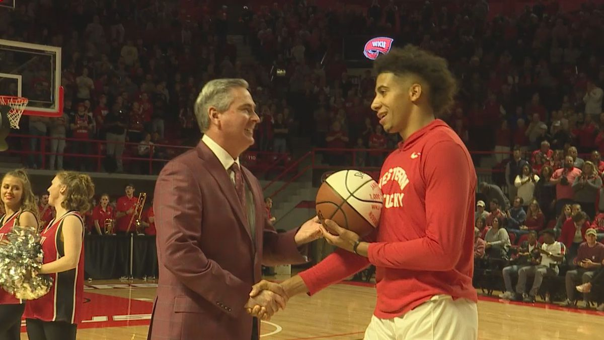 Rick Stansbury with Jared Savage before WKU's game against Arkansas 12-7-19