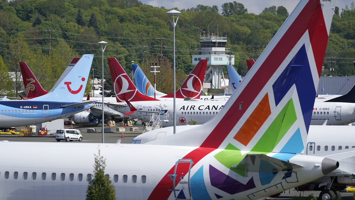 In this April 26, 2021, file photo Boeing 737 Max airplanes sit parked in a storage lot, near...