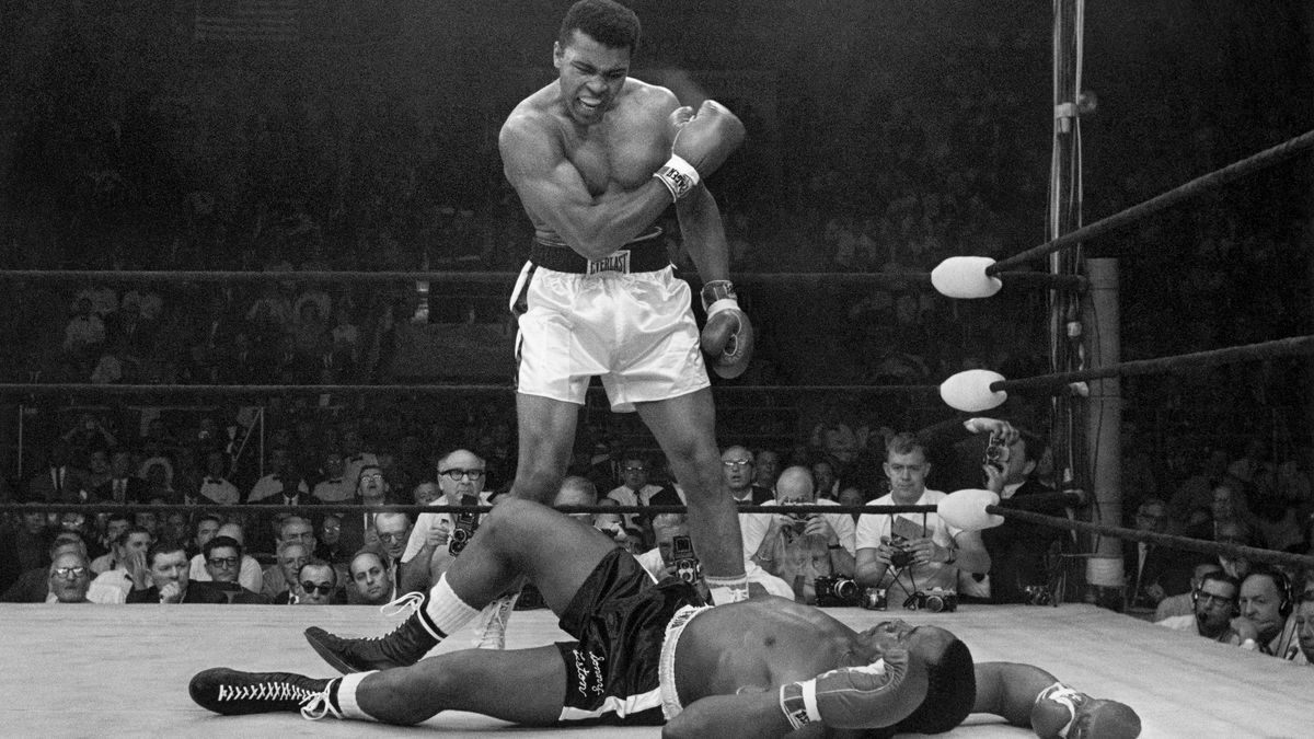 FILE - In this May 25, 1965 file photo, heavyweight champion Muhammad Ali stands over fallen...