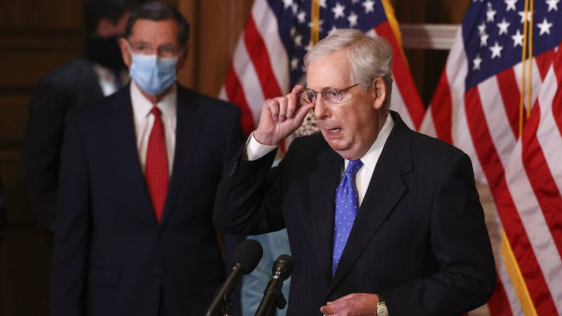 Senate Majority Leader Mitch McMcConnell of Ky., speaks to reporters on Capitol Hill in...