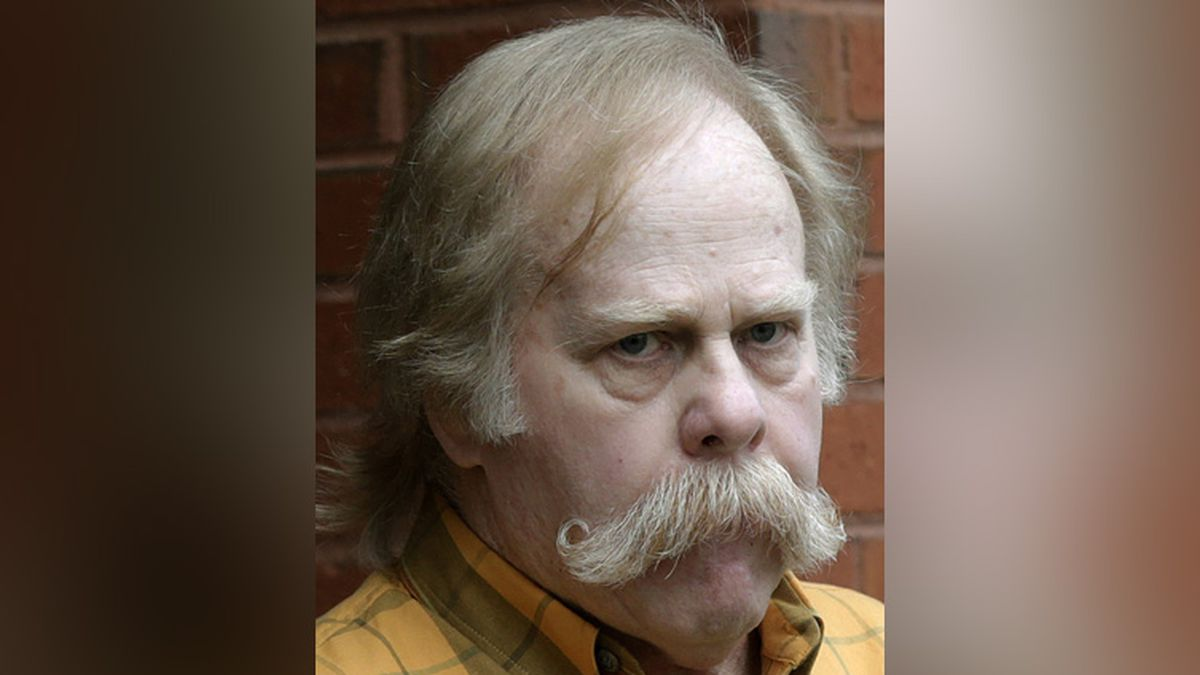 FILE - In this June 10, 2013 file photo, University of Alabama fan Harvey Updyke departs the Lee County Justice Center in Opelika, Ala., after pleading guilty earlier to poisoning landmark oak trees at Auburn University. Updyke has died. He was 71. .