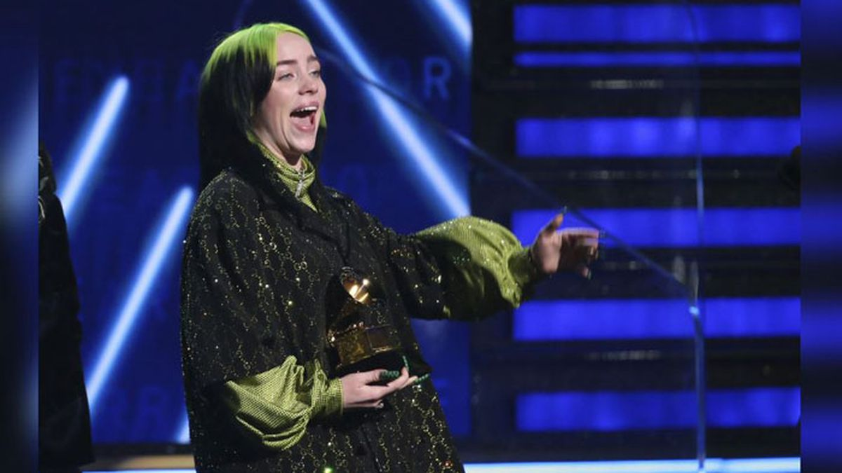 """Billie Eilish accepts the award for record of the year for """"Bad Guy"""" at the 62nd annual Grammy Awards on Sunday, Jan. 26, 2020, in Los Angeles. (Source: Matt Sayles/Invision/AP)"""