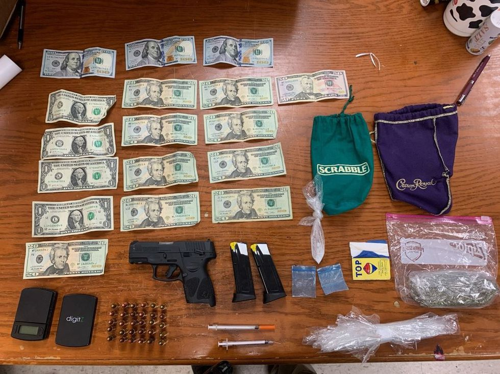 Drugs, cash,  hand gun, and other items found during traffic stop on Wilson