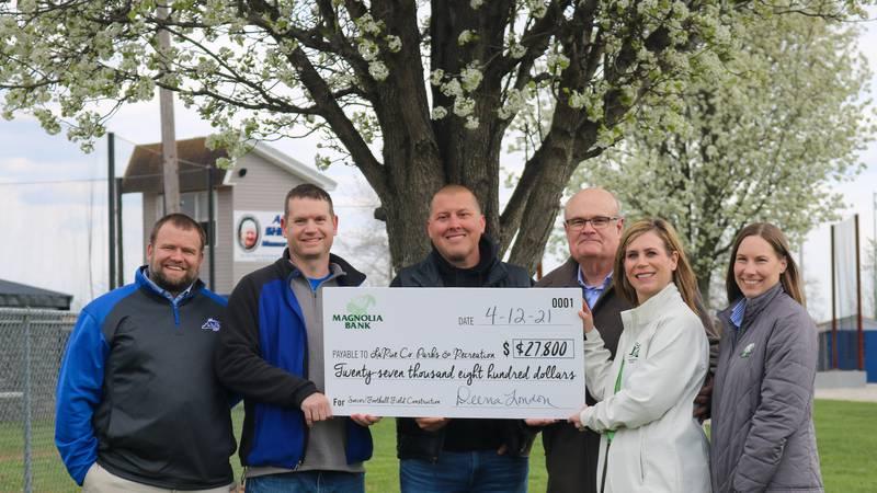 Magnolia Bank presents $27,800 to LaRue Parks & Recreation.