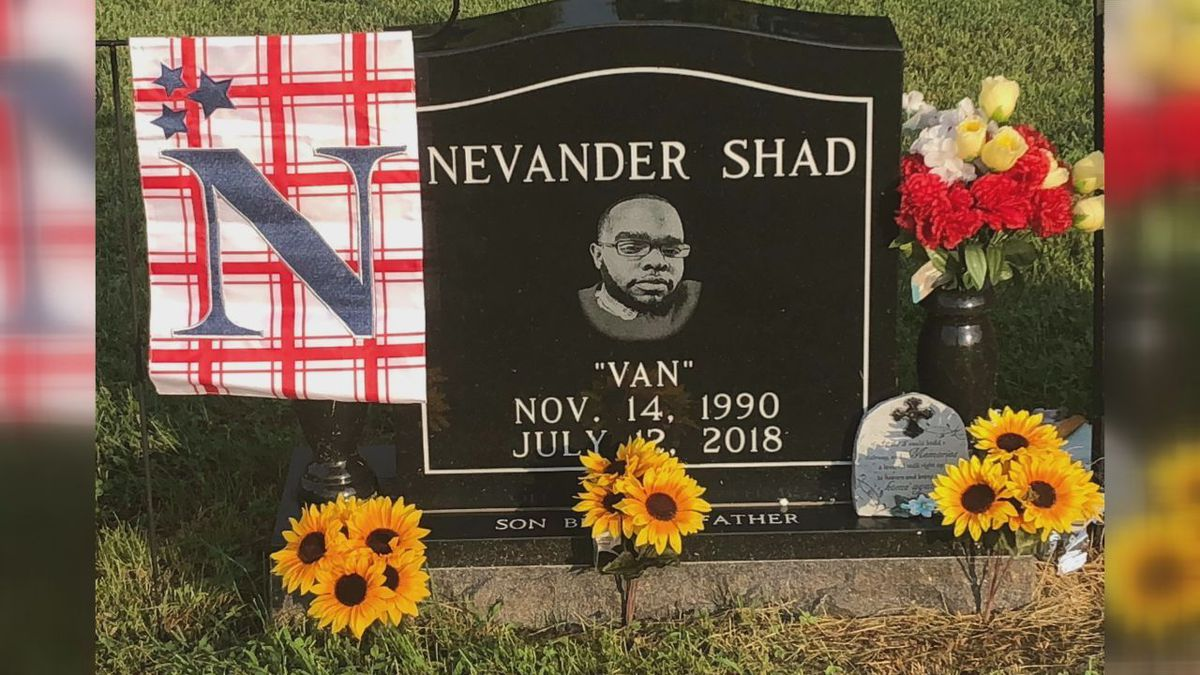A new garden flag stands by Nevander Tardy's grave as the search for his killer continues.