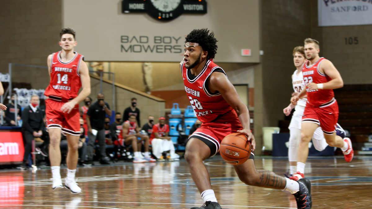 SIOUX FALLS, SD - NOVEMBER 25: Dayvion Mcknight #20 of the Western Kentucky Hilltoppers pushes...