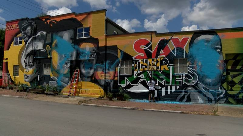 """The """"Say Their Names"""" mural on 11th Street, created in July 2020 to honor the lives of Breonna..."""