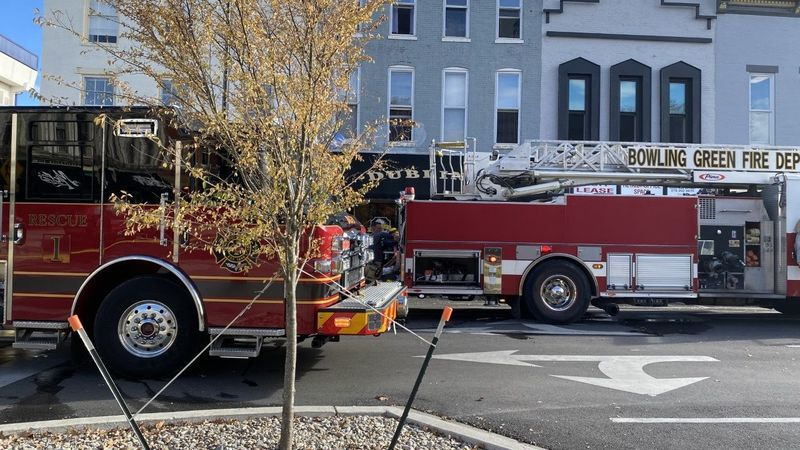 Firetrucks park on State Street as first responders put out fire at local pub.