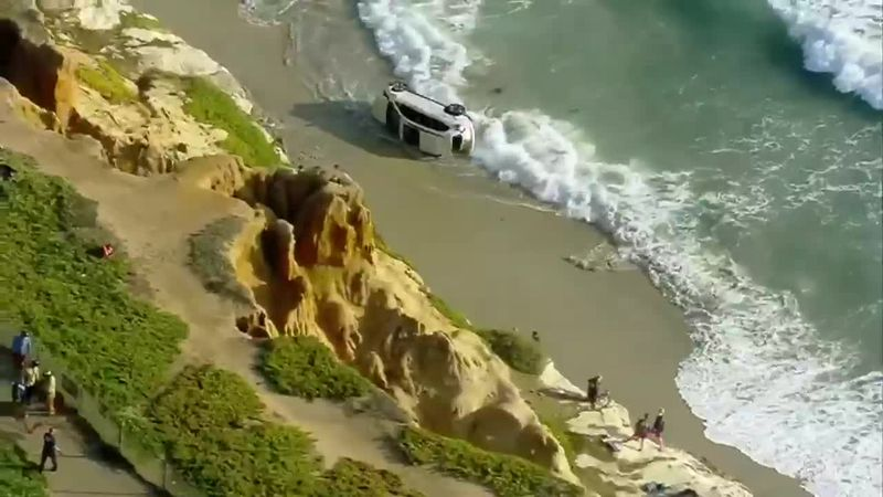 Officials say the man drove through a guardrail and fence, falling onto south Carlsbad Beach,...