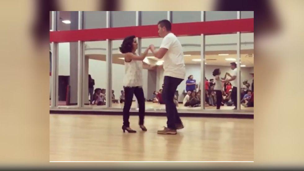 Julia and her husband dance for a Zumba night.