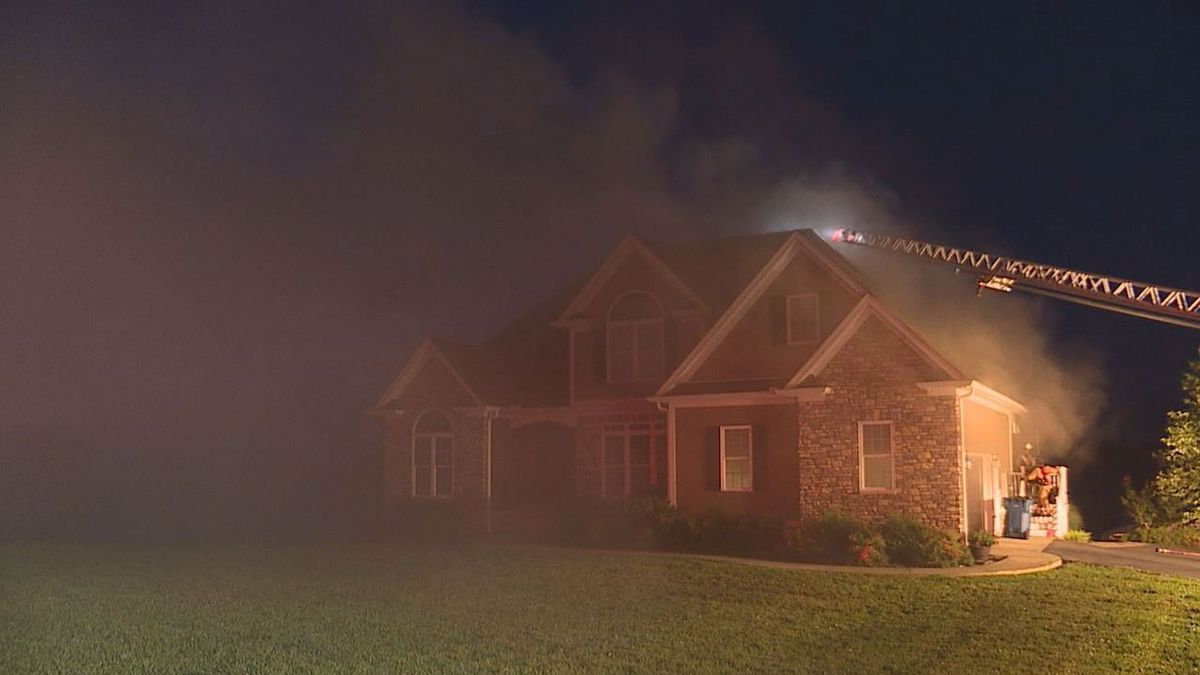 Multiple fire departments responded to a house fire in Alvaton early Friday morning. (Photo: Madison Martin)