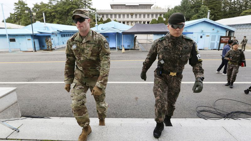 FILE - In this April 26, 2019 file photo, South Korean and U.S. Army, left, soldiers patrol...