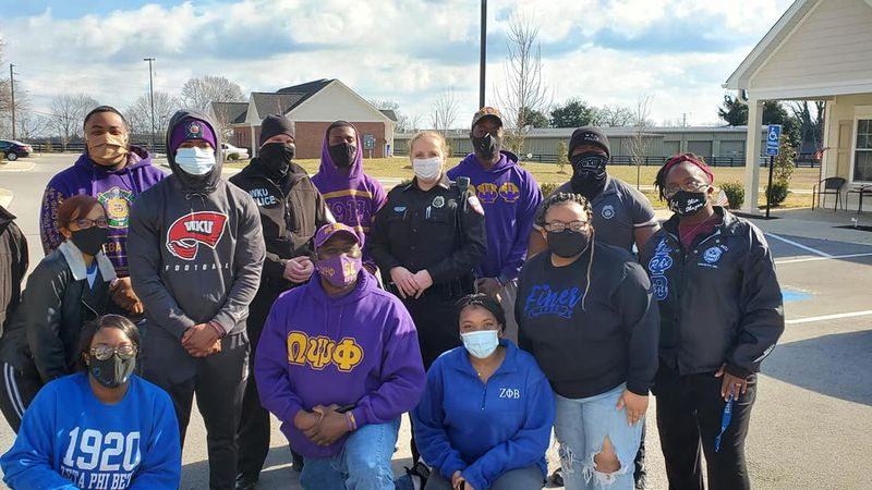 Officers with BGPD and WKU PD along with members of Omega Psi Phi and Zeta Phi Beta pose for a...