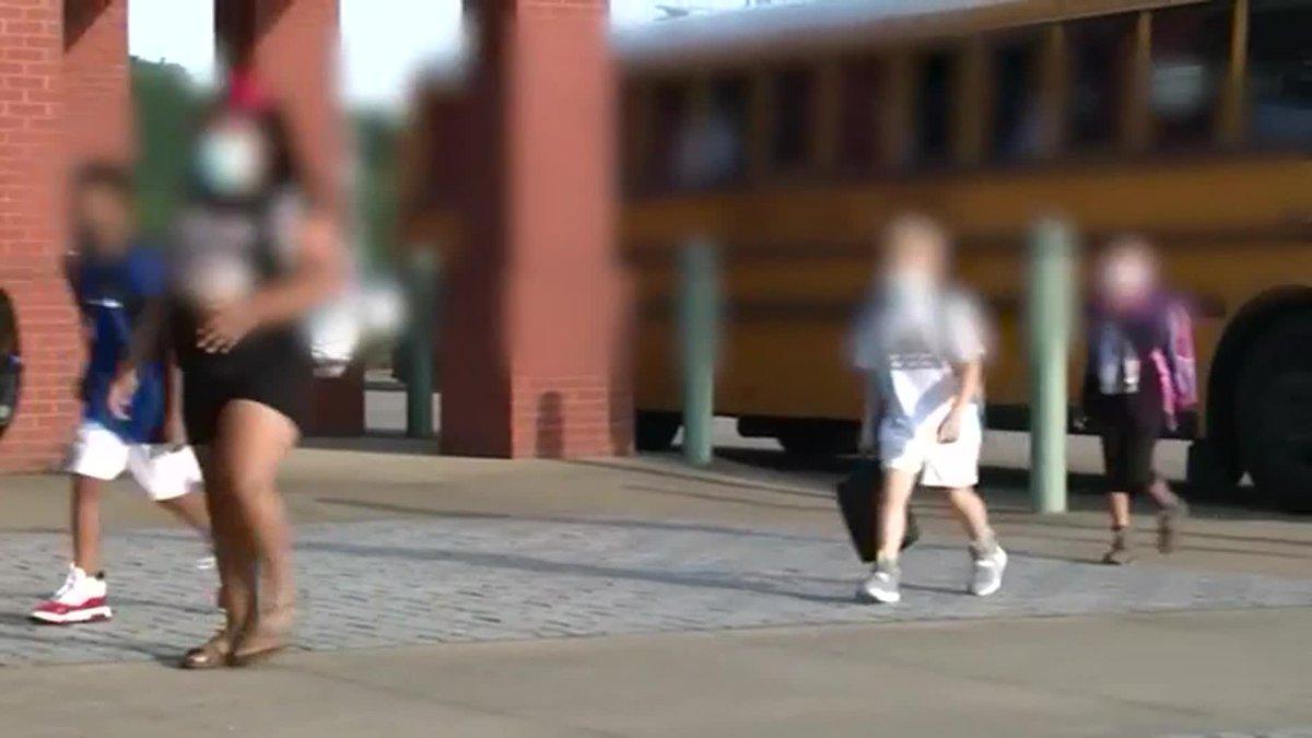 Kids return to school amid mask debate.