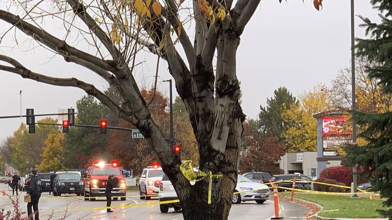 Police close off a street outside a shopping mall after a shooting in Boise, Idaho on Monday,...
