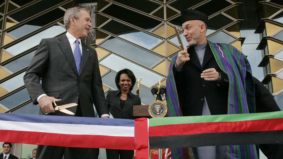FILE - In this March 1, 2006 file photo, U.S. President George W. Bush, left, and Afghan...