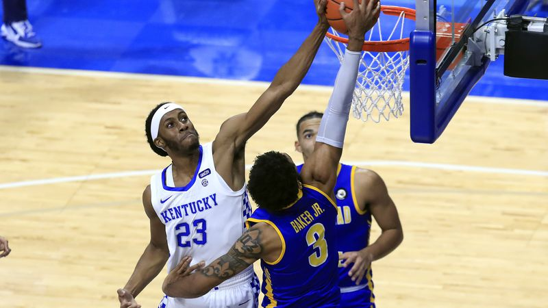 Morehead State's James Baker (3) has his shot blocked by Kentucky's Isaiah Jackson (23) during...