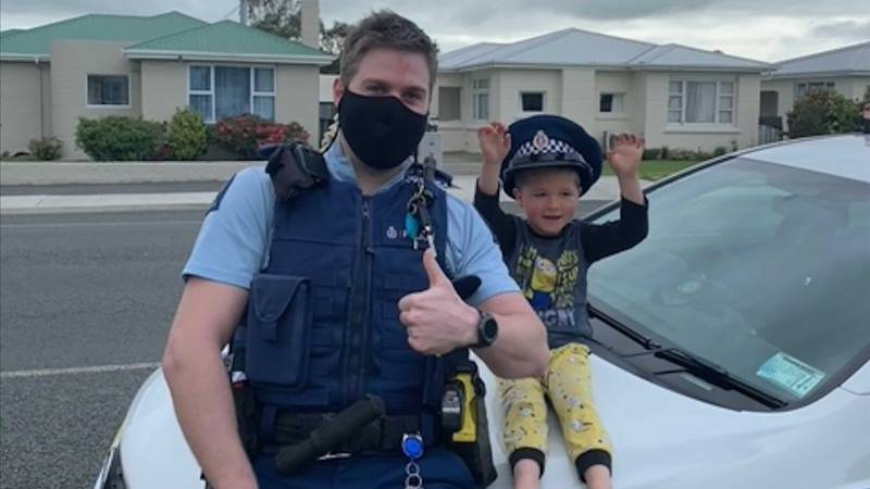 In this photo released by New Zealand Police, an officer identified only as Constable Kurt sits...