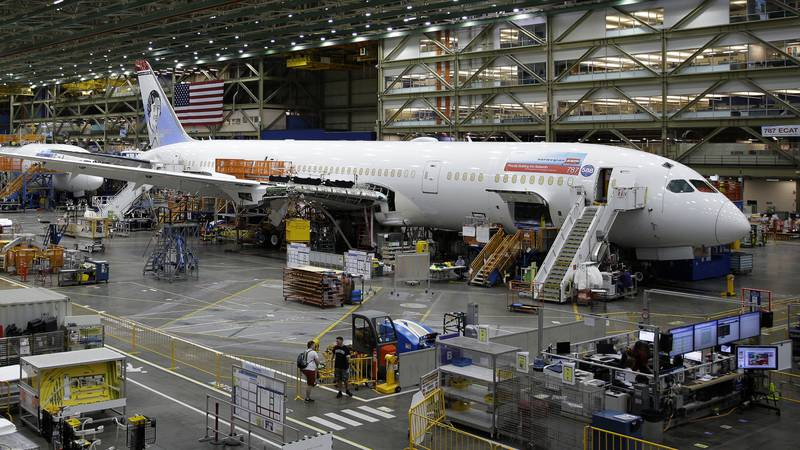 In this June 12, 2017, file photo, a Boeing 787 airplane being built for Norwegian Air Shuttle...
