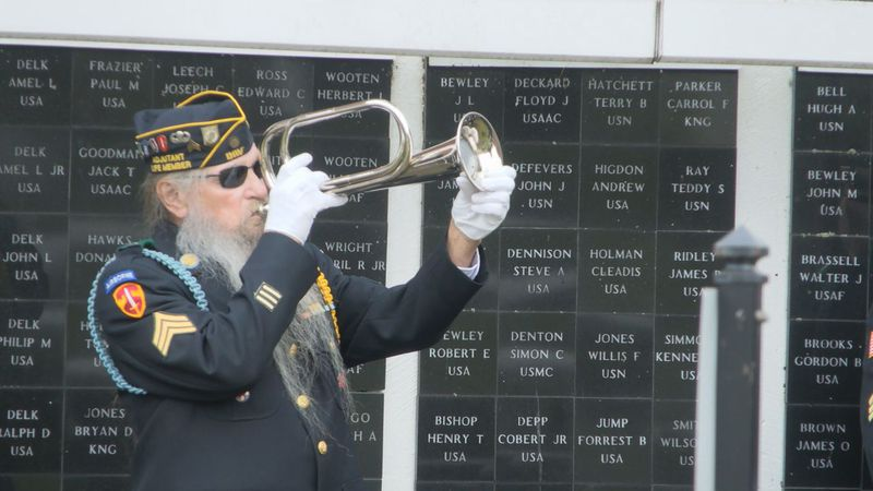 'Taps' played at the Veterans' Wall of Honor during Veterans Day ceremony.