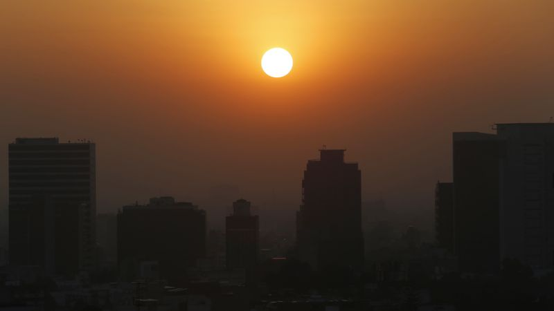 FILE - In this Thursday, Feb. 20, 2020 file photo, the sun rises amid smog during the dry...