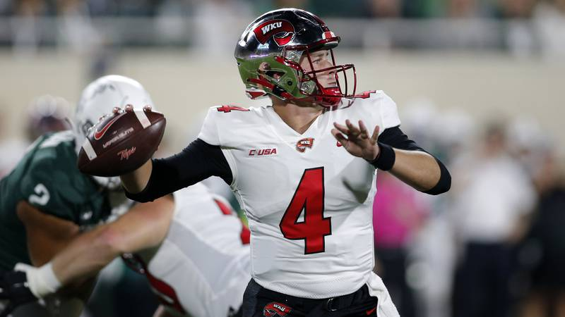 Western Kentucky quarterback Bailey Zappe looks to throw a pass against Michigan State during...