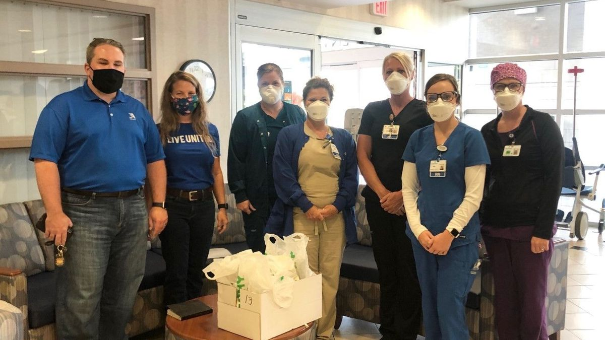 Employees of 3A Composites bring lunch to workers at T.J. Sampson Urgent Care.