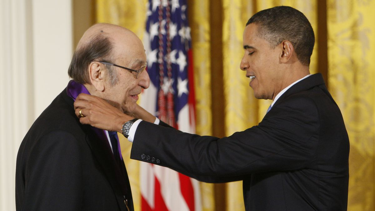 """In this Thursday, Feb. 25, 2010, file photo, President Barack Obama presents a 2009 National Medal of Arts to Milton Glaser, in the East Room of the White House in Washington. Glaser, the designer who created the """"I (HEART) NY"""" logo and the famous Bob Dylan poster with psychedelic hair, died Friday, June 26, 2020, his 91st birthday."""