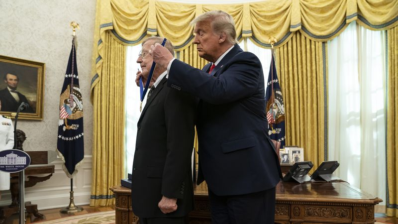 President Donald Trump presents the Presidential Medal of Freedom to former football coach Lou...