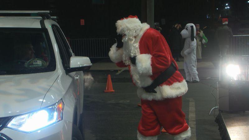 Santa talks to a child at the SoKy Marketplace Monday evening (WBKO)