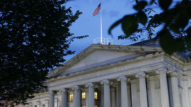 This Thursday, June 6, 2019, photo shows the U.S. Treasury Department building at dusk, in...