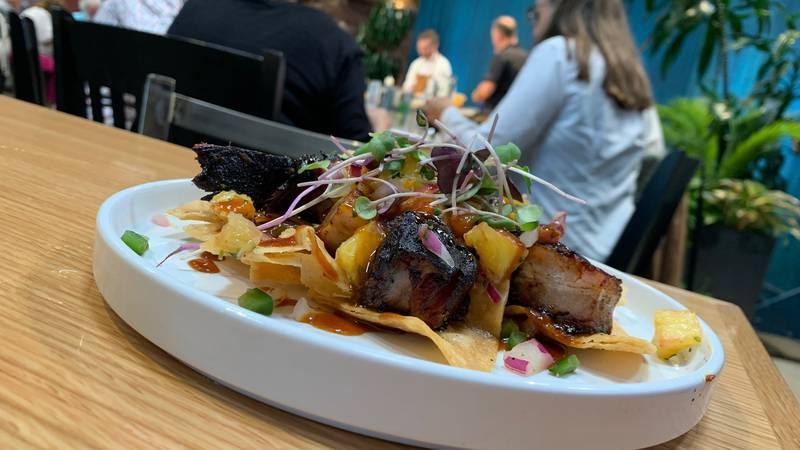 Jackson Skelton, Executive Chef at LouVino, prepared pork belly nachos at a recent show taping.