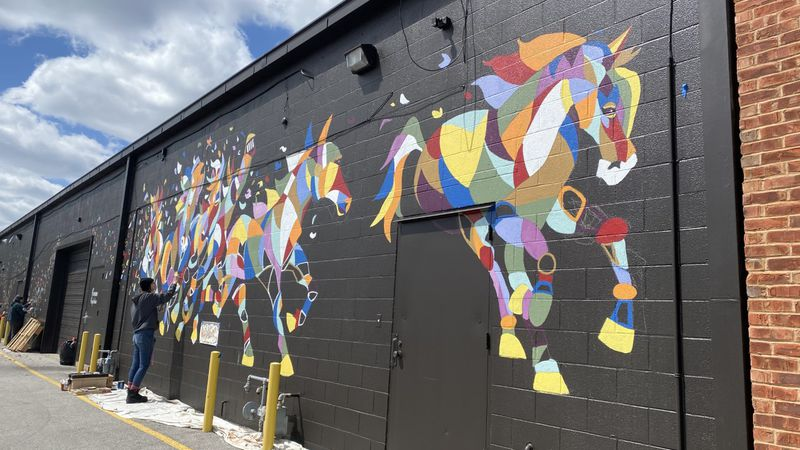 SKYCTC art students painted a new mural at Thoroughbred Shopping Center.
