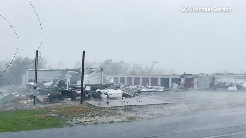 Simon Brewer took video Sunday from Golden Meadow, Louisiana. It shows roofs off of buildings...