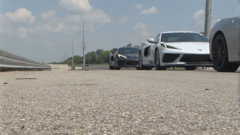 Race car driver, Andy Pilgrim teaches driver safety course.