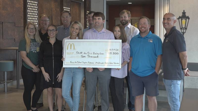 Local McDonalds gives check to Stuff the Bus check for $10,000