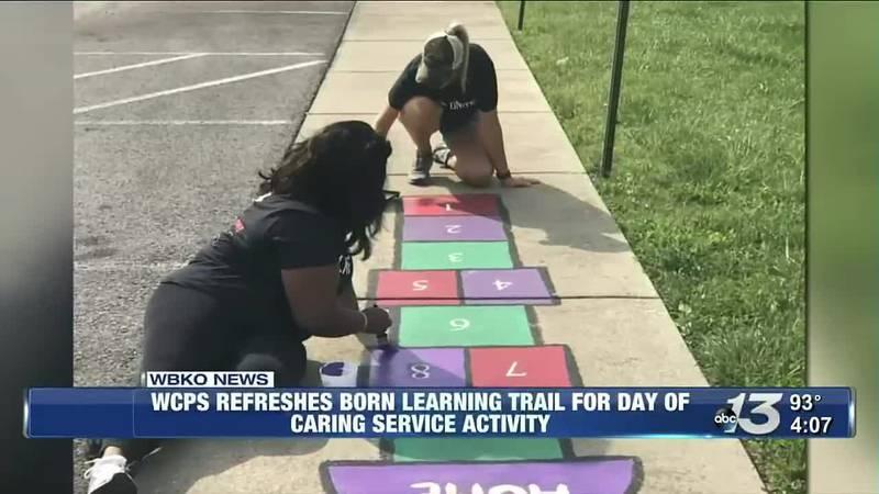 WCPS refreshes born learning trail for day of caring service activity