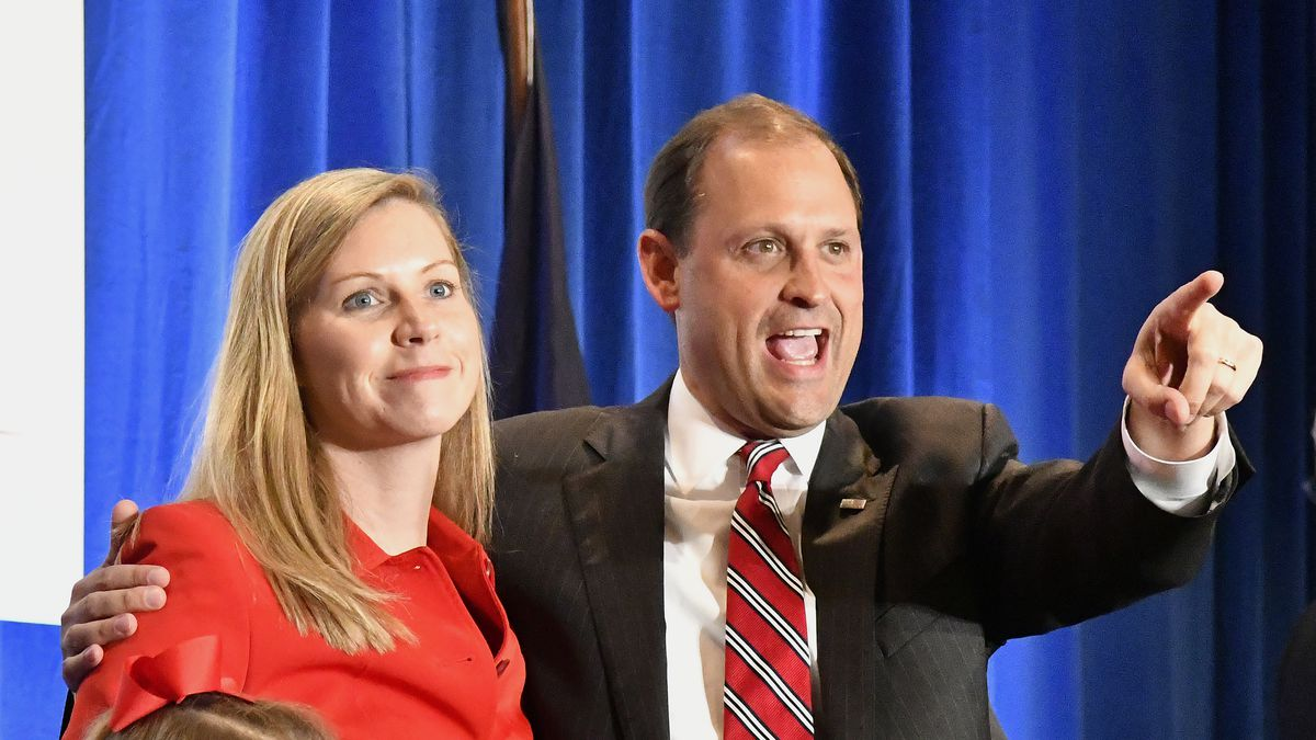 Rep. Andy Barr, R-Ky., right, and his wife, Carol, look out over the crowd of his supporters at his victory celebration in Lexington, Ky., Tuesday, Nov. 6, 2018. (AP Photo/Timothy D. Easley)