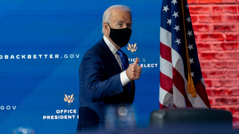 President-elect Joe Biden said he will ask Americans to commit to 100 days of wearing masks as...