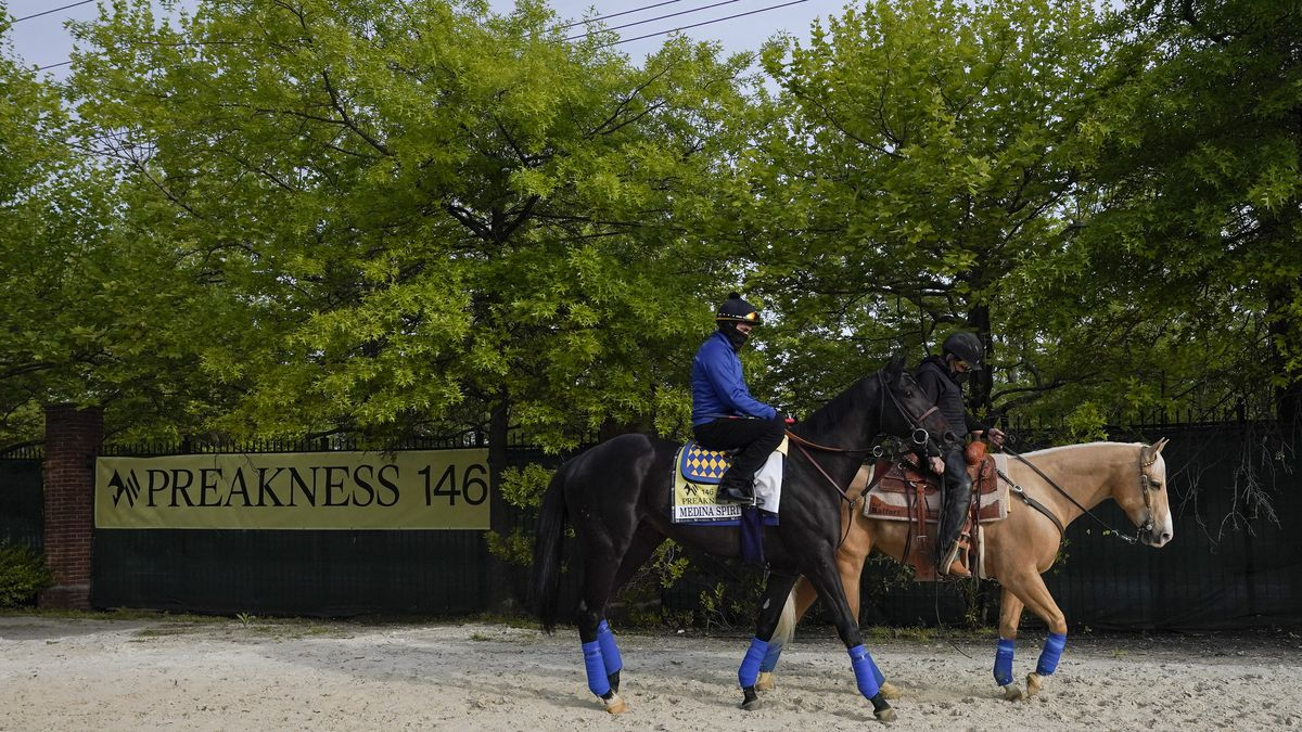 Exercise rider Humberto Gomez, top left, takes Kentucky Derby winner and Preakness entrant...