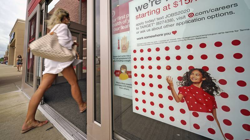 In this Sept. 2, 2020, file photo, a help wanted sign hangs on the door of a Target store in...