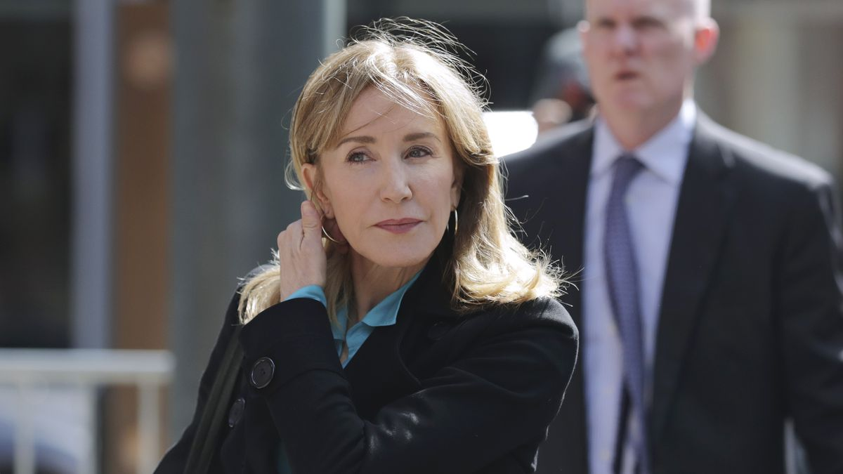 Actress Felicity Huffman arrives at federal court in Boston on Wednesday, April 3, 2019, to face charges in a nationwide college admissions bribery scandal. (AP Photo/Charles Krupa)