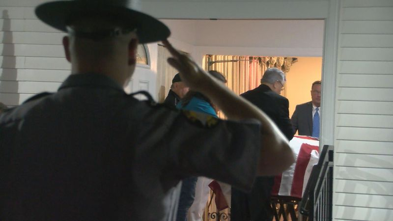 Family, vets, police welcome home WWII vet for the first time in over 80 years.