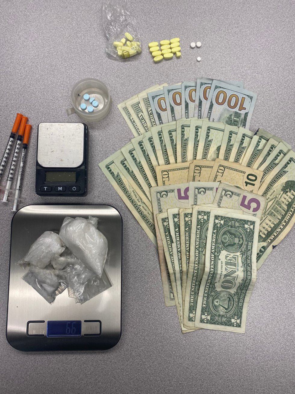 Drugs, cash, and drug paraphernalia found during search of residence
