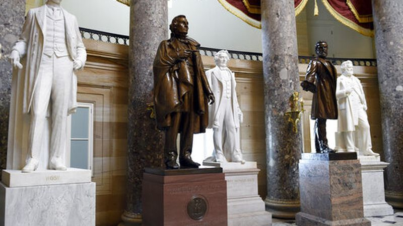 FILE - In this June 24, 2015 file photo, a statue of Jefferson Davis, second from left,...