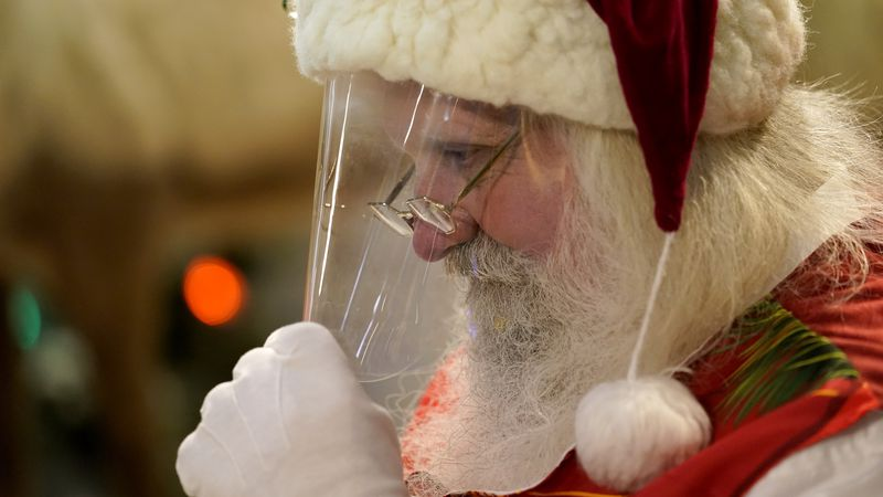This is Santa Claus in the Coronavirus Age, where visits are done with layers of protection or...