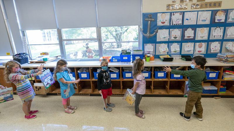 FILE - In this Oct. 6, 2020, file photo, kindergarten students check to make sure they are...