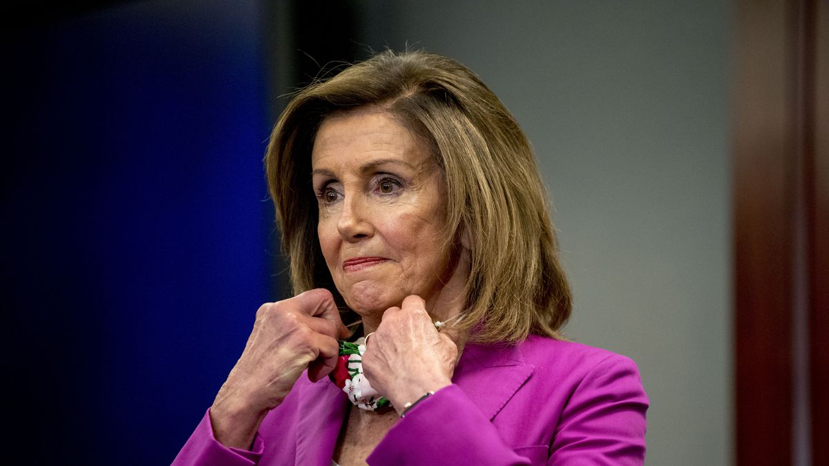 House Speaker Nancy Pelosi of Calif., puts her mask back on after speaking at a news conference on District of Columbia statehood on Capitol Hill, Tuesday, June 16, 2020, in Washington. House Majority Leader Steny Hoyer of Md. will hold a vote on D.C. statehood on July 26. (AP Photo/Andrew Harnik)