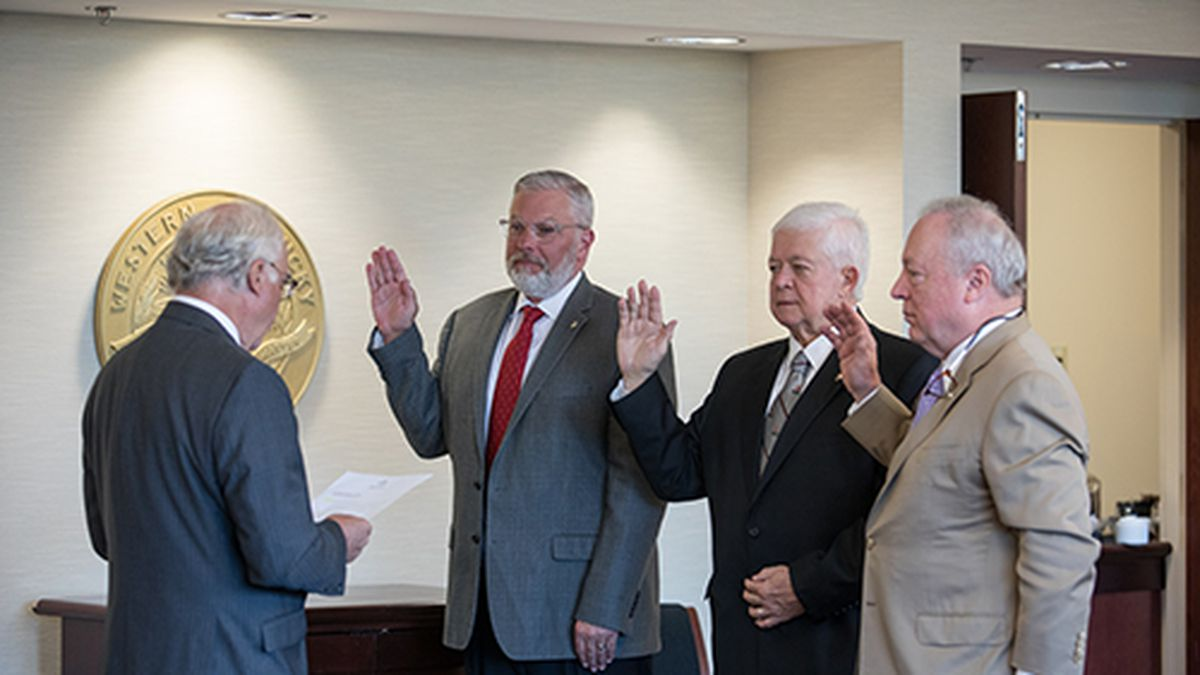 Dr. Phillip Bale (left) administered the oath of office to the WKU Board of Regents' new...